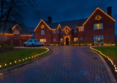 Residential house and driveway with lights