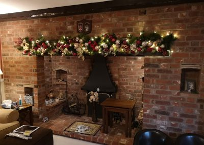 Garland alwayd looks great above fireplaces here in traditional